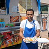 Egyptian Grill Owner Makar Sodky with a chicken/lamb dish. The truck is stationed at Riverside Street in Lowell.