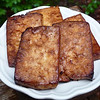"<h1>Soy Glazed Tofu</h1> Another great recipe from Robin Robertson's <u><b><a href=""http://www.amazon.com/gp/product/0470085029/ref=as_li_tf_tl?ie=UTF8&tag=mayoowbr-20&linkCode=as2&camp=217153&creative=399353&creativeASIN=0470085029"">1,000 Vegan Recipes</a></b></u>.   This one is quick and easy to fix up ... it needs 30 minutes to marinate and 30 minutes to bake, but your actual working time is only around 15 minutes to slice and press the tofu and mix up the marinade.  This is great hot, right out of the oven; at room temp; or cold.  So good that I have to make sure I don't eat the whole, entire recipe at one sitting!!  Thanks to Robin for allowing her book to be part of Google Books Search, <b><u><a href=""http://books.google.com/books?id=jeFz24WOHq8C&lpg=PA245&vq=soy glazed tofu&dq=soy glazed tofu&pg=PA283#v=onepage&q&f=false"">recipe is here</a></u></b>."