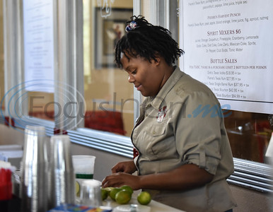 Kiepersol bartender Alani Parks cuts limes while serving guests during the winery's annual Vine Day event on Saturday, October 19. The event is meant to give thanks for a bountiful harvest and pray for rest over the vineyard as it prepares for the next season. (Jessica T. Payne/Tyler Morning Telegraph)
