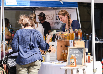 An event-goer purchases honey from a local vendor during the Kiepersol Winery Vine Day event on Saturday, October 19. The family-run business also includes a steak house restaurant, boutique, upscale RV park and bed & breakfast rooms. (Jessica T. Payne/Tyler Morning Telegraph)