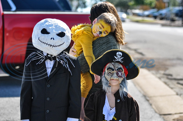 (From left to right) Luke Fields, 9, Truett Fields, 2, and Levi Fields, 5, stop for a photo in their costumes while attending the community celebration marking the 70th Anniversary of The Village Bakery in Tyler. The event took place on Saturday, October 27. (Jessica T. Payne/Tyler Morning Telegraph)