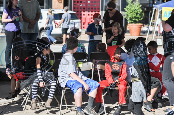 Children play musical chairs at the 70th Anniversary of The Village Bakery in Bergfeld Center. The community celebration took place on Saturday, October 27. (Jessica T. Payne/Tyler Morning Telegraph)