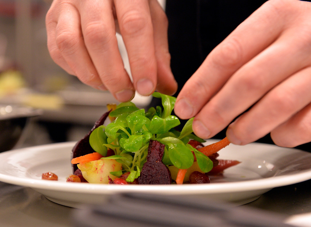 . David Coleman, Executive Chef, puts the finishing touches on a Curried Winter Root Vegetable Salad at Chianina Steak in Long Beach, CA. December 18, 2013. The new restaurant will be open on December 27th. (Thomas R. Cordova/Press-Telegram/Daily Breeze)