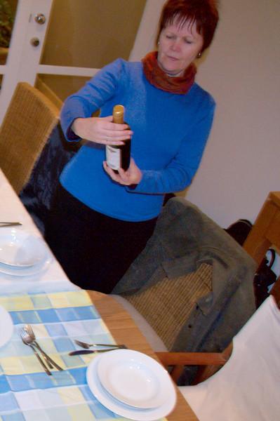 Geraldine examines the wine.