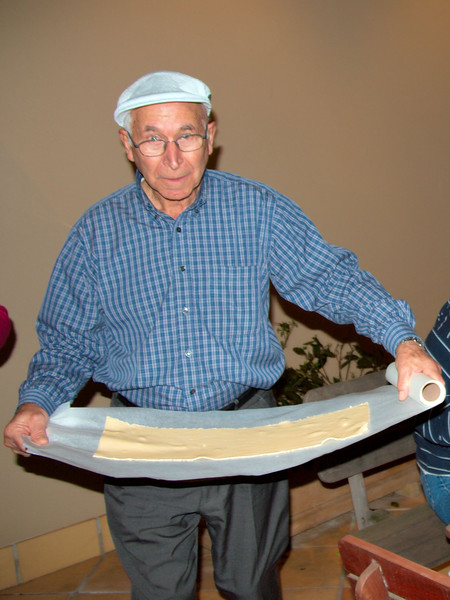 "Tony brings out another sheet of pasta from the ""Pasta Preparation Room"" to the ""Ravioli Assembly Courtyard""."