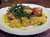Pan-seared queen scallops served on butternut squash risotto drizzled with sage and garlic butter