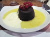 Squidgy chocolate pudding with white chocolate and orange sauce (and ice cream)