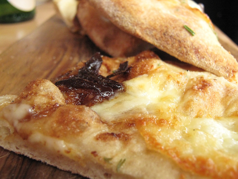 Garlic bread topped with cheese and caramelised onions