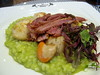 Seared king scallops on pea risotto with pulled ham hock