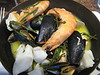 Hot seafood pot (clams, crevettes, mussels, salmon, and haddock, in a liquor of wine, butter, and garlic)