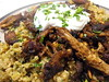 Hand-pulled turkey shawarma with dates and pine nuts on a bed of freekeh with a dollop of labneh