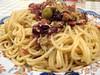 Spaghetti with olives, lardons, and feta