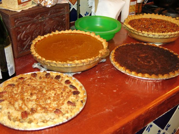 "And guess what? FOUR pies for 8 people.  Turned out Ellen's daughter brought canned pumpkin from California, so she made a pumpkin pie and a pecan pie in the toaster oven.  Ellen voluteered to cover the top of mine with whipped cream to camouflage its darkened top (a gallant attempt save my reputation), but I declined, se we put it on the side.  I have to say, the flavor tasted just like home, though the crust was more powdery than flaky.  Hearsay is that Mexican flour has little or no gluten which would explain the softness of the dough. I have not been able to verify this, though I know different wheats produce flours of varying gluten contents.  Let me know, Dear Readers, if you can shed light on this baking dilemma.  And, by the way, the Apple Pecan pie (which mom would say is ""gilding the lily,"" was really yummy, though first prize from the small circle of voters went to the pecan pie."