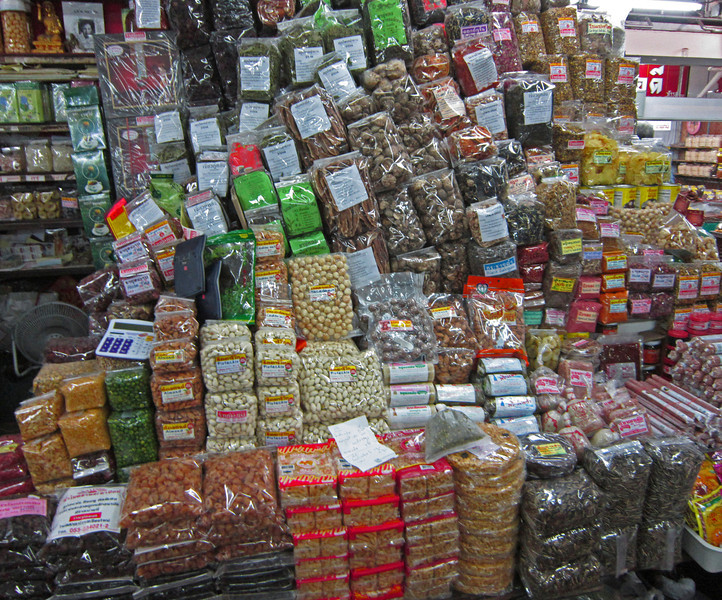 A selection of dried fruits, seeds, nuts and noodles.