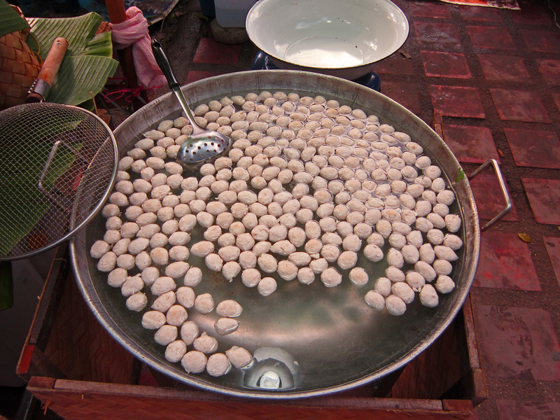 These are fishballs made of ground fish and dough and formed into a ball and cooked in hot water.