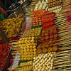 Lots of precooked food is offered as take away snaks on bamboo skewers