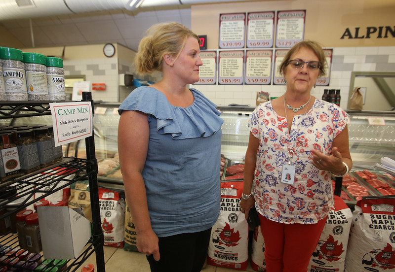 Alpine Butcher on Chelmsford Street in Lowell. Beef consumption is up in the U.S. Customers Kim Crawford of Atkinson, N.H., left, and Gail Bennett of Windham, N.H., who both work at Cross Point across the street. (SUN/Julia Malakie)