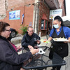 Athenian Corner restaurant is open for outdoor dining as part of phase 2 of reopening the economy during the COVID-19 pandemic. Server Leyla Apache of Lowell brings salad and tzatziki to Celeste and husband Bob Dunn of Chelmsford. (SUN/Julia Malakie)