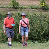 Autumn Hills Orchard in Groton has pick your own raspberries and apples, and is harvesting peaches. Jim and wife Deirdre Heck of Chelmsford return with raspberries they'd picked. (SUN/Julia Malakie)