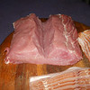 Split the loin along the grain of the meat leaving a 1/2 inch or so intact.