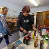 Deedee Dorrington, left, and Taryn Gillis, both of Billerica, pick out items for customers at the Emergency Food Pantry at First Congregational Church in Billerica. The next regular Billerica Food Pantry is not until March 30, and the Marshall Middle School food pantry that was scheduled for this past Thursday was cancelled as Billerica schools were closing on Friday. (SUN/Julia Malakie)
