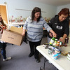 From left, Nicole Sounders, a student home from RIT, her mother Diana Sounders, and Taryn Gillis, all of Billerica, pick out items for customers at the Emergency Food Pantry at First Congregational Church in Billerica. The next regular Billerica Food Pantry is not until March 30, and the Marshall Middle School food pantry that was scheduled for this past Thursday was cancelled as Billerica schools were closing on Friday. (SUN/Julia Malakie)