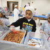 Volunteers package meals of rice, pinto beans, soy, dried vegetables, seasoning and vitamins, organized by The Outreach Program, at Anjuman-e-Ezzi in Billerica. From left, Mariyah Khokhar, 9, Shrewsbury, Humza Jagmag, 8, of Nashua, and Ruqaiya Mehboob, 9, of Billerica, help measure ingredients. (SUN/Julia Malakie)