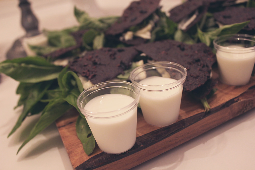 Oil-Cured Olive & Cacao Nib Wafer Sandwich w/ Preserved Lemon & Basil Cream Filling, served w/ Milk Shots. @Goody Goodie Cream & Sugar Dessert Salon.