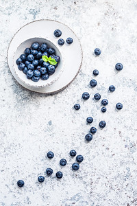 Blueberry Antioxidant Organic Superfood. Fresh Blueberries On Blue Background. Juicy Wild Forest Ber