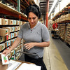 Linda Esquibel puts together a large seed order at Botanical Interests on Thursday.<br /> Botanical Interests Seeds process a variety of seed packets at their Broomfield location.<br /> Cliff Grassmick / February 25, 2010