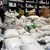 Sacks of bulk seeds are collected for organizing.<br /> Botanical Interests Seeds process a variety of seed packets at their Broomfield location.<br /> Cliff Grassmick / February 25, 2010