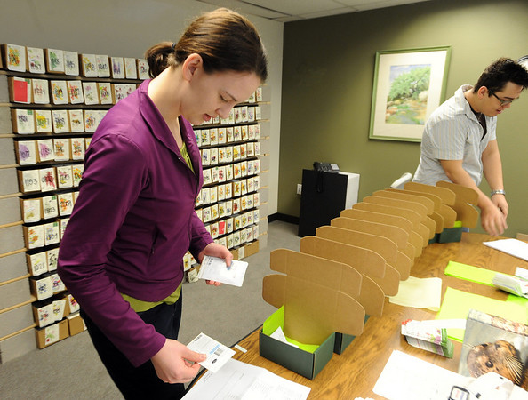 Shayna Lashway and Blake Stevens fill online seed orders at Botanical Interests.<br /> Botanical Interests Seeds process a variety of seed packets at their Broomfield location.<br /> Cliff Grassmick / February 25, 2010