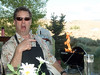 Chef Richard signals first flame on his Weber kettle at Burgeroff 2007.