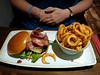 """Classic Cheese Shack Burger - 8oz burger topped with monterey jack cheese, smoked streaky bacon, garnish and relish. £6.95. Served with twisty fries. Served in """"The Shack"""" in Torquay<br /> <br /> 27/08/14"""