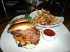 "American style burger - double smoked bacon, aged cheddar cheese & rustic fries. C$13.50.  Served in ""Milestones"" in London, Ontario  01/02/14"