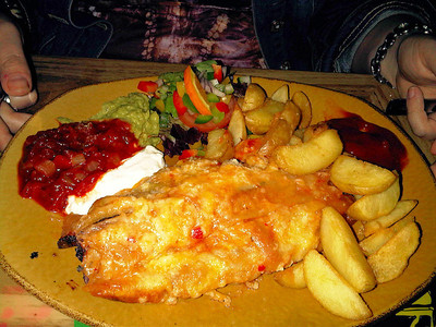 "Enchiladas - Two rolled tortillas filled with spicy tomato sauce with Cajun Chicken filling topped with grilled Jack cheese. £10.99. Served in ""The Rio Grande"" in Newton Abbot  19/05/12"