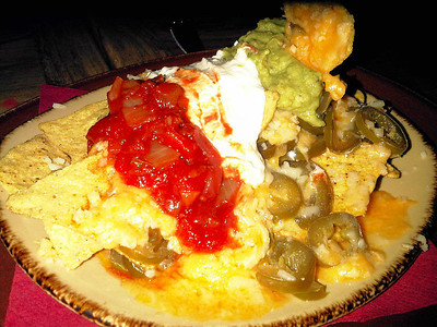 "Nachos - Tortilla chips topped with melting jack cheese, jalapeno peppers, guacamole, sour cream & smoky salsa. £3.99. Served in ""The Rio Grande"" in Newton Abbot  19/05/12"