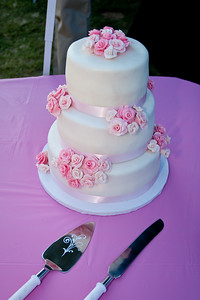 3 Layer fondant cake with strawberry filling and pink fondant roses.