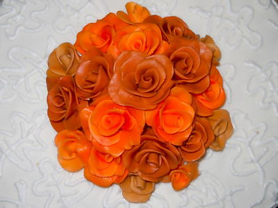Autumn Wedding cake, Chocolate mousse filling, Arctic White butter cream frosting, edible fondant roses.