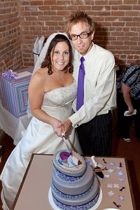 Amanda and Brian cut their 3 layer Topsy-Turvy cake. Edible printed topper, from an original painting by Brian Billings.