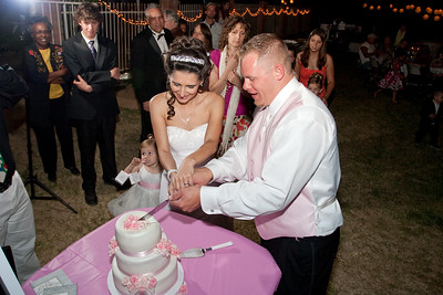Angela and Emil cut their 3 Layer fondant cake with strawberry filling and pink fondant roses.
