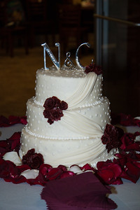 White Fondant 3 Tier Wedding Cake, with strawberry, cherry, and raspberry filling.