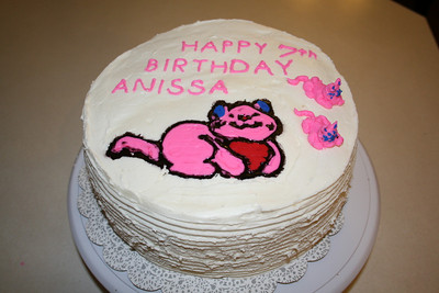Anissa's Cake March 2012. She wanted a pink kitty with blue ears on a white cake.