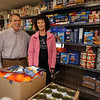 Linda and Bob LaPorte of Chelmsford at the Chelmsford Food Pantry, which they have taken over running, from the late founder/director Sandy Donovan. (SUN/Julia Malakie)