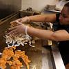 Herradura Vieja Restaurante Mexicano, new Mexican restaurant on Summer Street in Chelmsford. Raquel Lopez of Chelmsford grills ingredients for a large takout order. (SUN/Julia Malakie)
