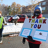 Drop-off at Chelmsford Food Pantry for food drive sponsored by State Rep. Tom Golden.  Diane Taylor, right and Judy Omodono, both of Chelmsford, greet arriving cars.(SUN/Julia Malakie)
