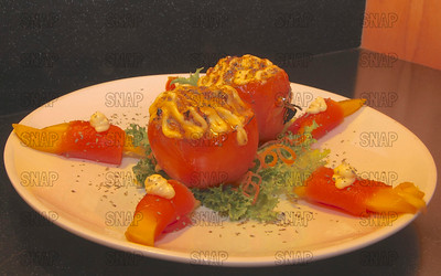 Stuffed Tomatoes: Tomatoes; Frisee Lettuce; Carrot Curls; Octopus; Crab; Shrimp, Red & Green Bell Peppers; Avocado, topped with kewpie mayonnaise.  Mango wrapped in tuna, around the sides, with kewpie mayonnaise.