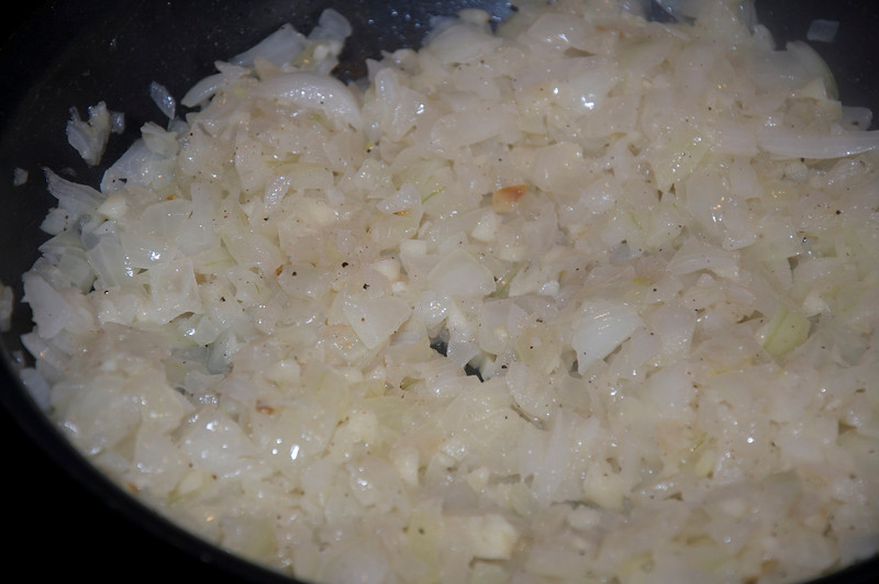 Saute the onion and garlic in tallow, until translucent.
