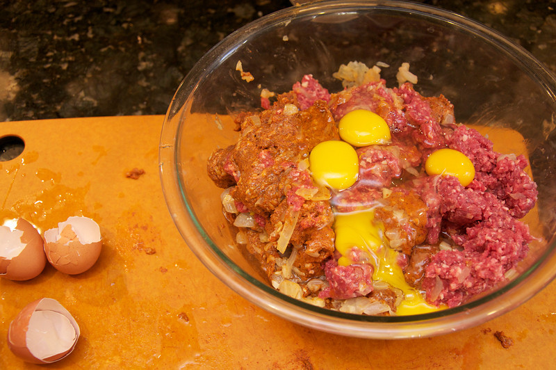 Add and mix together the chorizo, ground beef, and eggs to the onion garlic mixture.