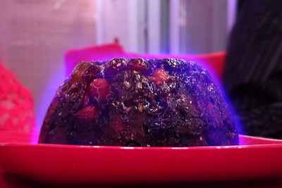 """Champagne Christmas Pudding - An indulgent Christmas pudding with with plump juicy vine fruits, crunchy almonds and peacons, enriched with lashings of Champagne and Brandy and topped with black, red and blonde cherries with a finishing touch of edible gold glitter. From """"Aldi"""""""